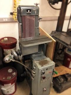Belt sander in machine shop